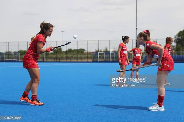Lola Riera of Spain and Berta Bonastre of Spain play a skills game as they warm up during the SemiFinal game between Ireland and Spain of the FIH...
