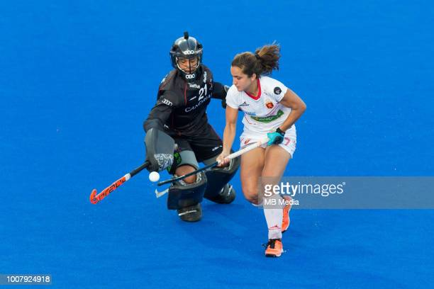 Lola Riera of Spain rounds Aisling D'Hooghe of Belgium in the penalty shootout but is unable to score during the crossover game between Belgium and...