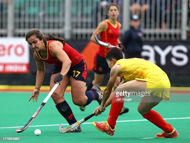 Lola Riera Zuzuarregui of Spain battles with Yan Yan of China during the Investec Hockey World League quarterfinal match between China and Spain at...