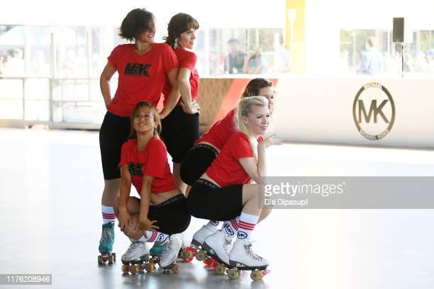 Lola Star's Dreamland dancers perform on the Michael Kors roller rink during Bustle's 2019 Rule Breakers Festival at LeFrak Center at Lakeside on...