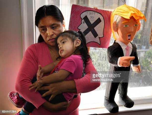 Lola Vargas and daughter Athena wait in their attorney's office before the deportation hearing of her husband Mario Vargas in Los Angeles California...