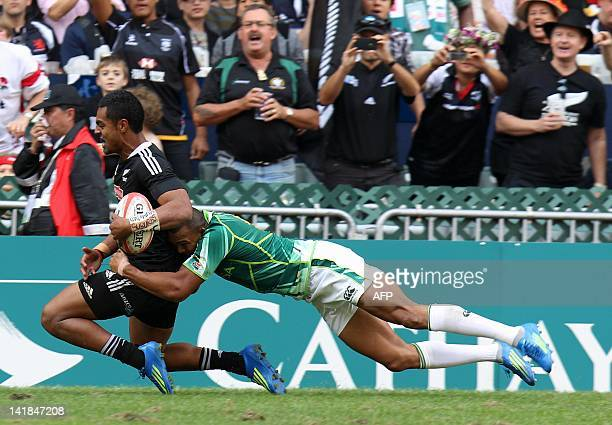 Lolagi Visinia of New Zealand is tackled by Cornal Hendricks of South Africa during the Hong Kong Rugby Sevens tournament on March 25 2012 AFP PHOTO...