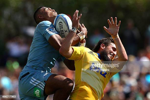 Lolagi Visinia of the Blues and Andre Taylor of the Hurricanes compete for a high ball during the Super Rugby Trial Match between the Blues and the...