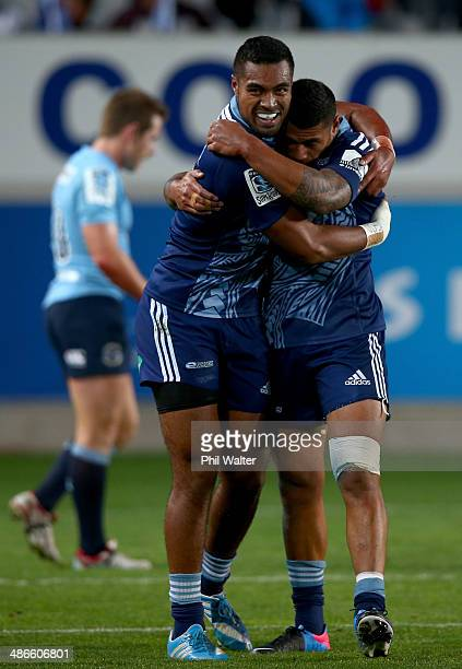 Lolagi Visinia of the Blues is congratulated on his try by Charles Piutau during the round 11 Super Rugby match between the Blues and the Waratahs at...