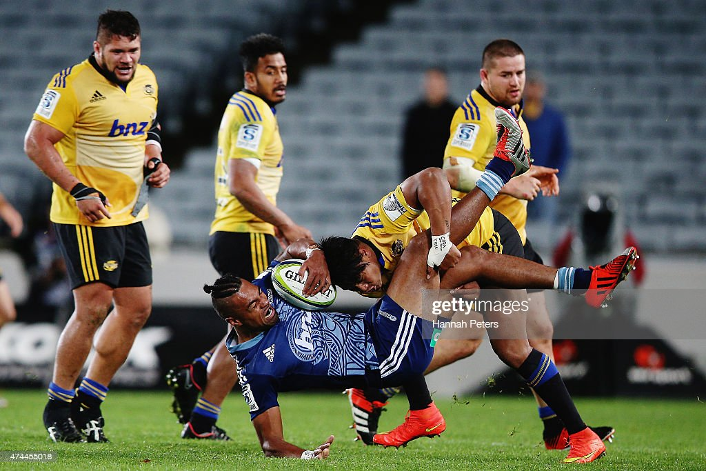 Lolagi Visinia of the Blues is tackled by Julian Savea of the Hurricanes during the round 15 Super Rugby match between the Blues and the Hurricanes at Eden Park on May 23, 2015 in Auckland, New Zealand.