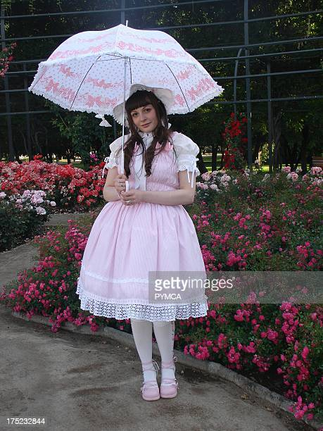 A Lolita girl dressed like Little Bo Peep and carrying an open parasol Santiago Chile 2009