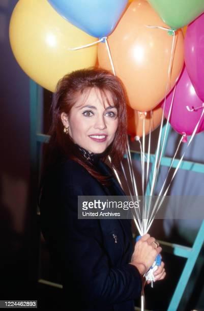 "Lolita Morena at an auction of costumes that TV presenter Hella von Sinnen at TV show ""Alles nichts oder"" wore, Cologne, Germany, 1992."