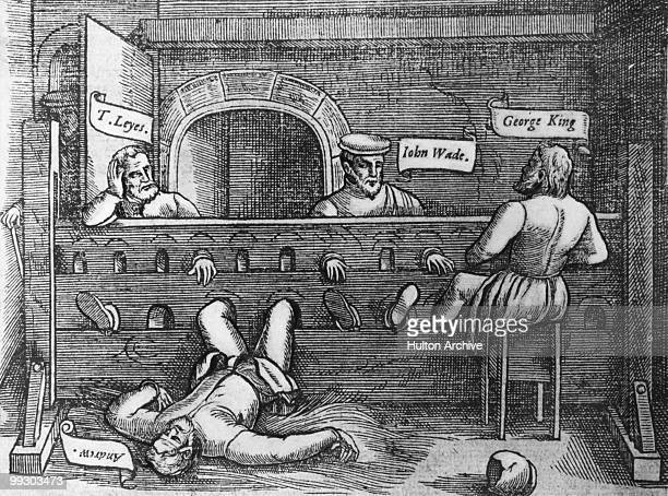 Lollards Thomas Leyes William Andrew John Wade and George King in the stocks in a cell in Lollard's Tower at Lambeth Palace London 1555 Lollards were...