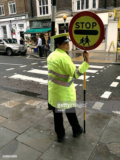 lollipop man, london - pedestrian crossing sign stock photos and pictures