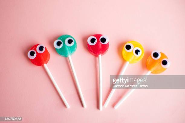 lollipops with cartoon eyes - anthropomorphic stock pictures, royalty-free photos & images