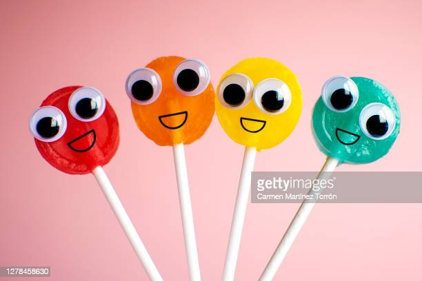 lollipops with cartoon eyes - googly eyes stock pictures, royalty-free photos & images