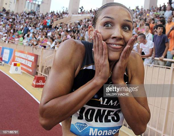 Lolo Jones celebrates after winning the 100m hurdles contest of the IAAF Diamond League athletics meeting, on July 22, 2010 at the Louis II stadium...
