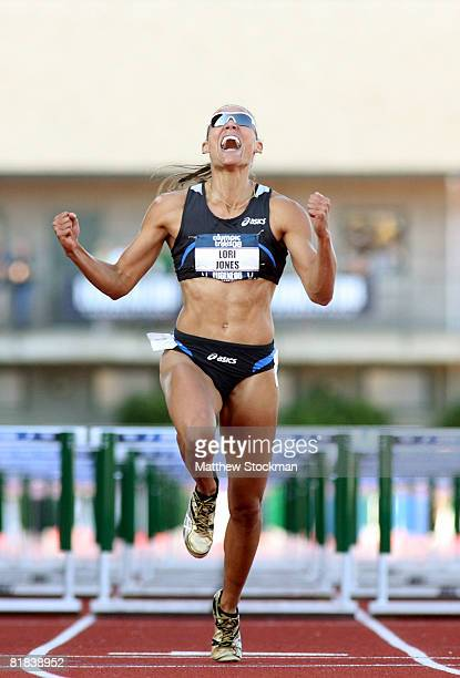 Lolo Jones celebrates as she crosses the finish line to win the gold medal in the women's 110 hurdles finals during day eight of the US Track and...