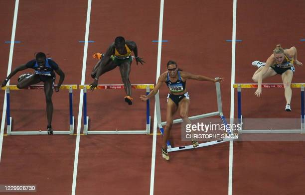 LoLo Jones of the US misses a hurdle as she competes against Dawn Harper of the US, Jamaica's Deloreen Ennis-London and Australia's Sally Mclellan...
