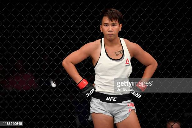 Loma Lookboonmee of Thailand standsin her corner between rounds of her women's strawweight bout against Alexandra Albu of Moldova during the UFC...