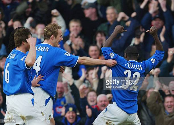 Lomana LuaLua of Portsmouth points to his name as he celebrates scoring his goal during the FA Barclaycard Premiership match between Portsmouth and...