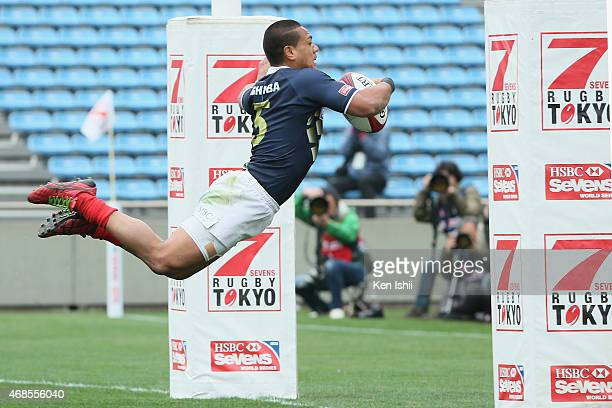 Lomano Lava Lemeki of Japan makes a try in the game between Argentina and Japan during the Tokyo Sevens Rugby 2015 on April 4 2015 in Tokyo Japan
