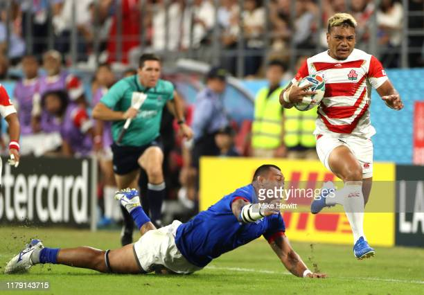 Lomano Lemeki of Japan gets past Piula Faasalele of Samoa during the Rugby World Cup 2019 Group A game between Japan and Samoa at City of Toyota...