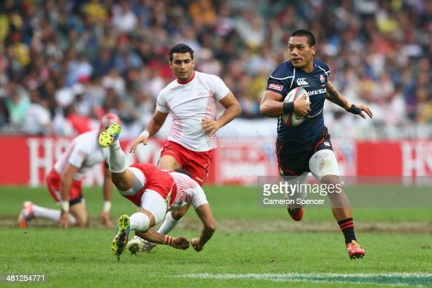 Lomano Lemeki of Japan makes a break during the Qualifying Quarterfinal match between Japan and Tunisia during the 2014 Hong Kong Sevens at Hong Kong...