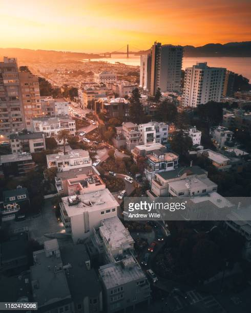 lombard street aerial sunset - lombard street san francisco stock pictures, royalty-free photos & images