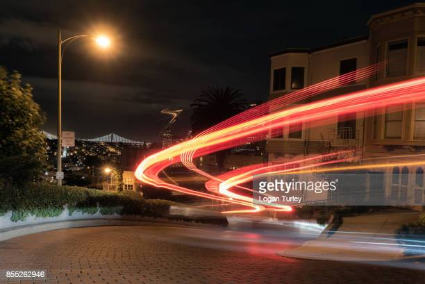 lombard street light trails - lombard street san francisco stock pictures, royalty-free photos & images