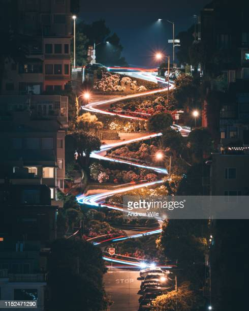 lombard street long exposure trail lights - lombard street san francisco stock pictures, royalty-free photos & images