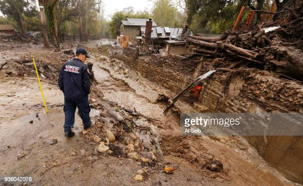 Lompoc Firefighter Chris Martinez who is with a Search and Rescue Regional Task Force scouts Montecito Creek at the East Valley Road crossing near...