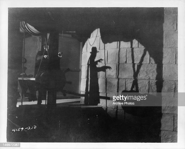 Lon Chaney casts a shadow in a scene from the film 'The Phantom Of The Opera' 1925