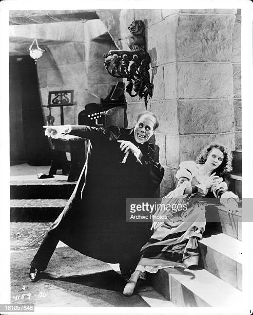 Lon Chaney guards Mary Philbin in a scene from the film 'The Phantom Of The Opera' 1925