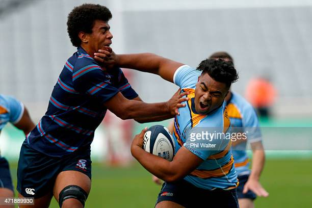 Lona Holaholo of Mount Albert Grammar is tackled by Hoskins Sotutu of Sacred Heart during the Schoolboys Rugby match between MAGS and Sacred Heart at...