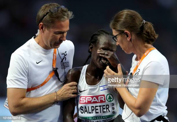 Lonah Chemtai Salpeter of Israel is given assistance after competing in the Women's 5000m Final during day six of the 24th European Athletics...