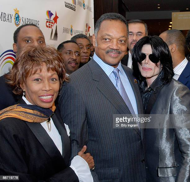 L Londell McMillan entertainer Michael Jackson Jesse Jackson and Altovise Davis attend Jesse Jackson's 65th birthday at the Beverly Hilton Hotel on...