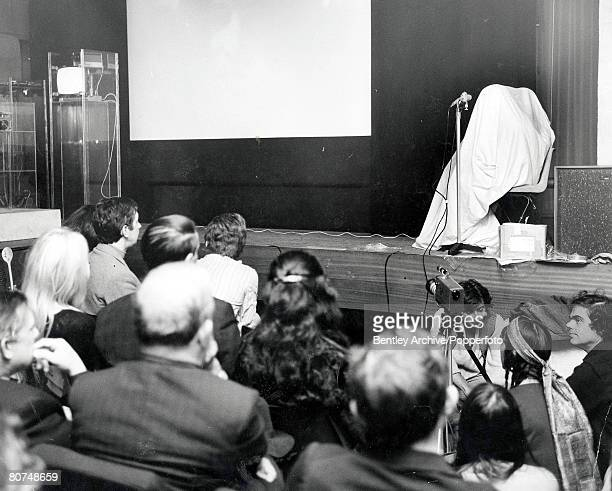 London, 11th September A couple, said to be pop star John Lennon and wife Yoko Ono appear on stage at the New Cinema Club inside a sack as part of...