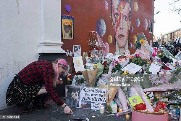 Fans of iconic English music artist David Bowie who died from Cancer at the age of 69 on Sunday 10th January gather to pay their respects at a...