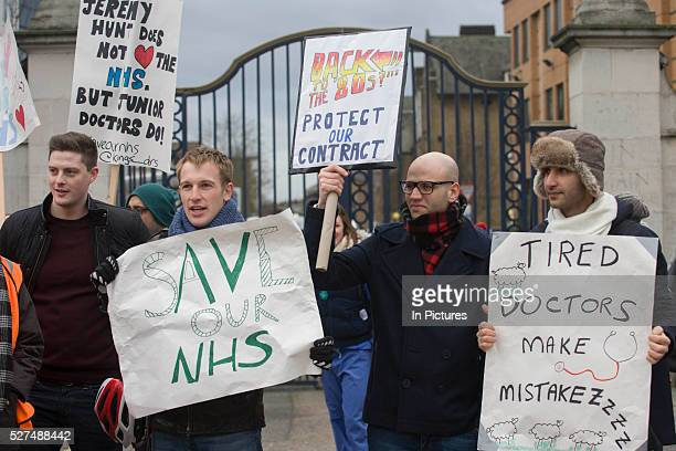 National Health Service Junior Doctors under the banner of the British Medical Association man a picket line outside Kings College Hospital in...
