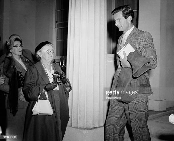 London, 14th October 1955, A little old lady makes sure she gets her camera ready to photograph RAF group Captain Peter Townsend as he leaves his home