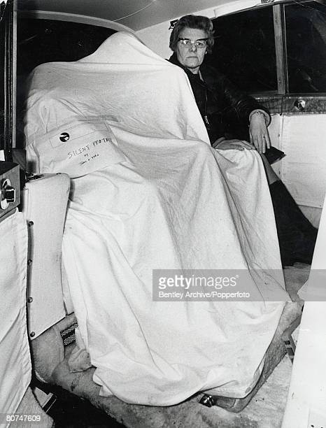London 15th December Pop star John Lennon and wife Yoko Ono appear inside a white sack in the back of a Rolls Royce car after they had made a speech...