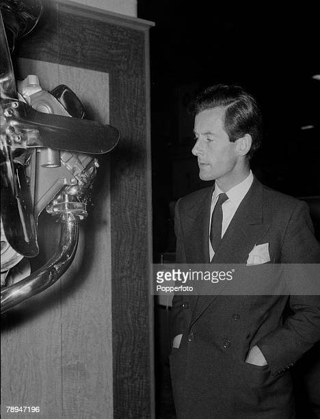 London, 18th October 1955, The Earls Court Motor Show, RAF Group Captain Peter Townsend looking at an engine exhibit at the show