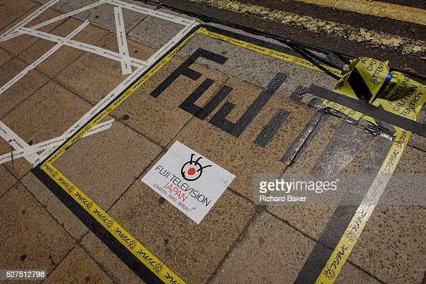 Japanese Fuji TV markings as tension mounts outside St Mary's Hospital Paddington London where media and royalists await news of Kate Duchess of...