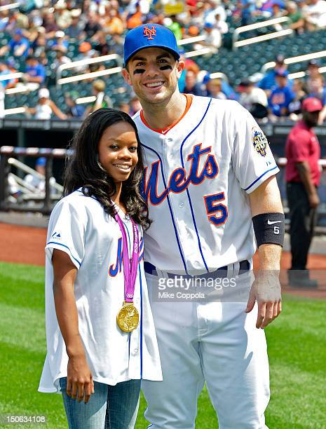 London 2012 Olympic games gold medalist Gabby Douglas poses for a picture with New York Mets third baseman David Wright Citi Field on August 23, 2012...