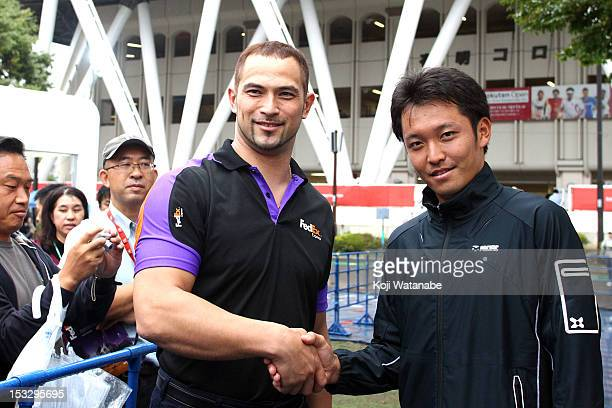 London 2012 Olympic Games the Men's Hammer Throw Bronze medalist Koji Murofushi of Japan and Tatsuma Ito of Japan shake hands during an autograph...