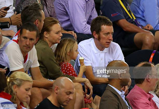 London 2012 Olympic gold medalist and 2012 Tour de France winner Bradley Wiggins of Great Britain sits next to fashion designer Stella McCartney as...