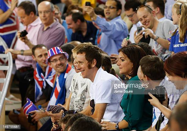 London 2012 Olympic gold medalist and 2012 Tour de France winner Bradley Wiggins of Great Britain smiles as he watches the track cycling next to his...
