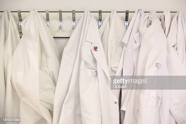 London 2012 pin badge is attached to a lab coat in the antidoping laboratory which will test athlete's samples from the London 2012 Games on January...