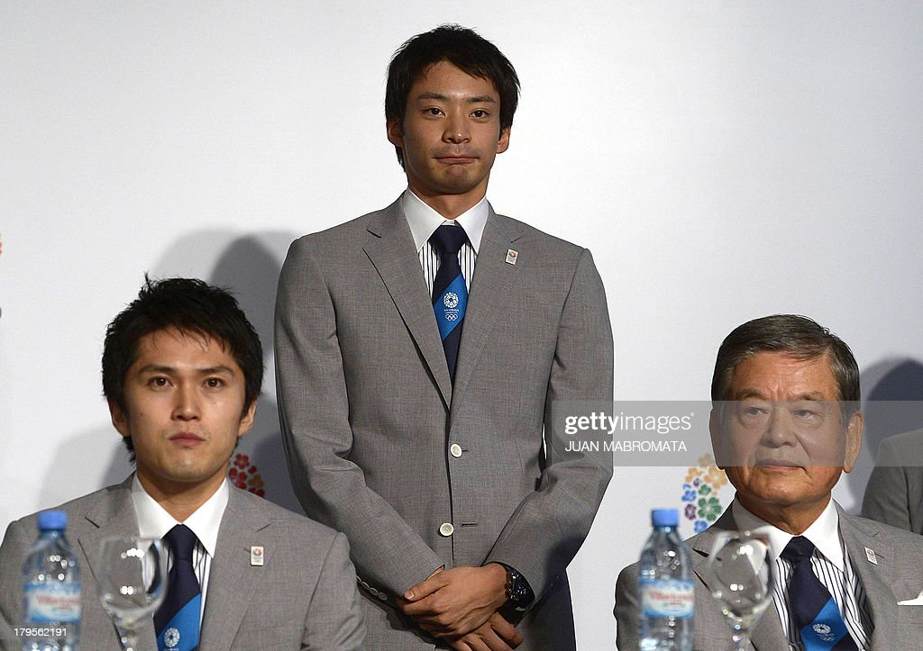 London 2012 swimmer Silver Medallist Ryosuke Irie (C) is seen admist Beijing 2008 and London 2012 fencing Silver Medallist Kenta Chida (L) and Tokyo 1964 Olympic Games footballer Saburo Kawabuchi during a press conference to promote Tokyo for 2020 Olympic games on September 5, 2013 in Buenos Aires. The IOC meets in Buenos Aires with all the interest centered around its September 7 session --involving all 103 members- - where the host city for the 2020 Summer Olympics will be elected. AFP PHOTO / Juan MABROMATA