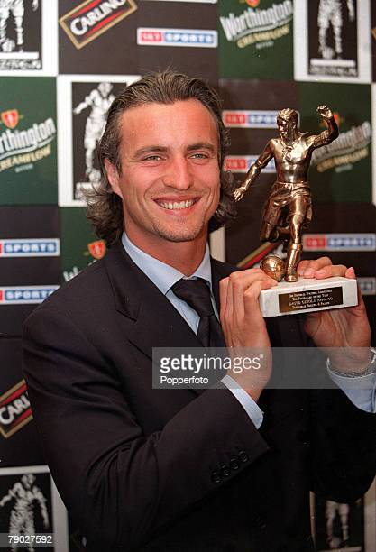 London 25th May Tottenham Hotspur player David Ginola holds his Football Writers Player of the Year trophy