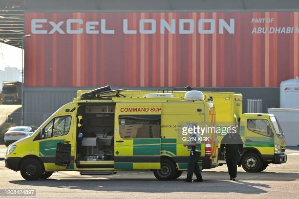 London Ambulance Service vehicles are seen in the east car park at the ExCeL London exhibition centre in London on March 27 that is being transformed...