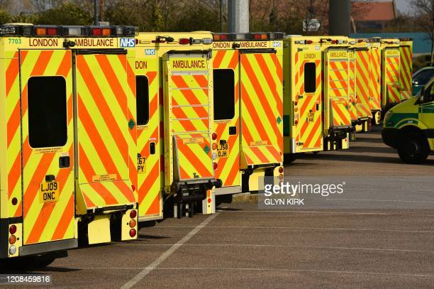 London Ambulance Service vehicles are seen in the east car park at the ExCeL London exhibition centre in London on March 28 that is being transformed...