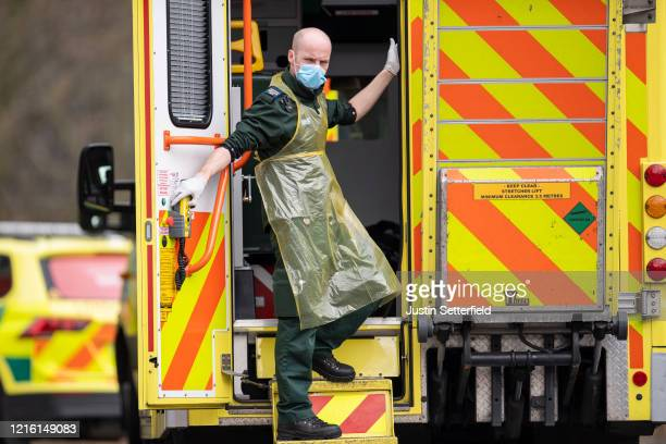 London Ambulance Service worker is seen in the back of an ambulance outside St Thomas' hospital on April 01 2020 in London England The Coronavirus...