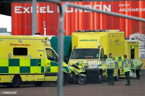 London Ambulance staff members work in the car park at the ExCeL London exhibition centre in London on March 30 which has been transformed into a...